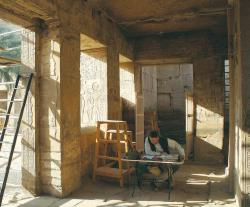 Brett McClain checking a collation at Medinet Habu.  Photo by Ray Johnson
