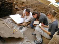 Brett McClain, Jen Kimpton, and Keli Alberts discussing a tracing at Khonsu Temple.  Photo by Ray Johnson