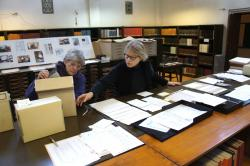 Ellie Smith and Sue Lezon assembling negatives for publication in Medinet Habu X.  Photo by Ray Johnson