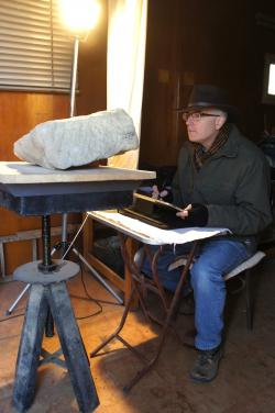 Jay Heidel penciling on Wacom tablet with Ptolemaic fragment, Luxor Temple.  Photo by Ray Johnson