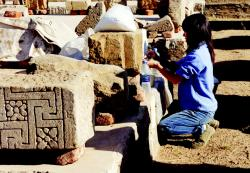 Hiroko Kariya treating inscribed fragments in Luxor Temple.  Photo by Ray Johnson