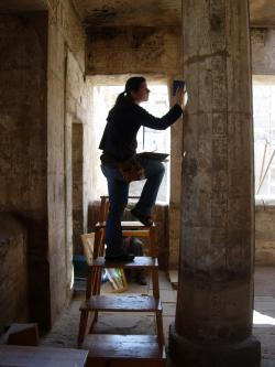 Jen Kimpton collating a drawing at Medinet Habu.  Photo by Ray Johnson