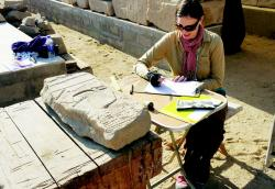 Julia Schmied recording fragments, Medinet Habu Blockyard.  Photo by Ray Johnson