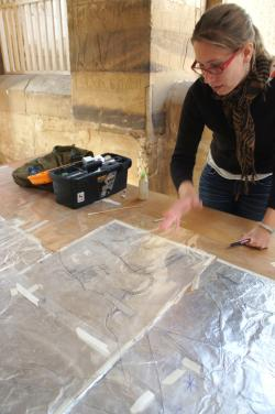 Keli Alberts assembling a drawing from foil impressions, Medinet Habu.  Photo by Ray Johnson