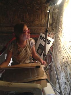 Keli Alberts recording a re-used block in Room I, Khonsu Temple.  Photo by Ray Johnson