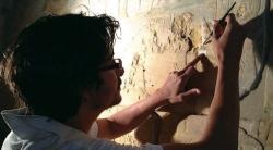 Lotfi Hassan treating wall reliefs in Medinet Habu.  Photo by Ray Johnson