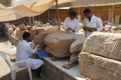 Lotfi Hassan and conservation students consolidating a block in the Medinet Habu blockyard.  Photo by Ray Johnson