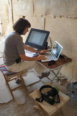 Tina Di Cerbo recording graffiti on the digital drawing tablet, Medinet Habu.  Photo by Ray Johnson
