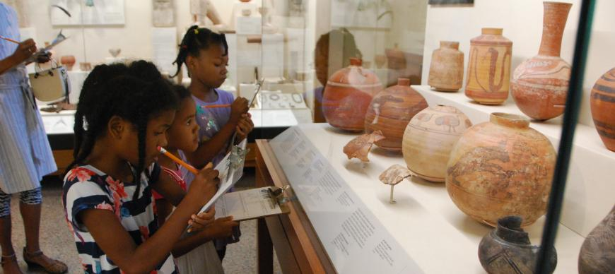 Image: Kids study ancient pottery from Nubia.