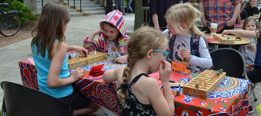 Image: Kids play games at the OI's Ancient Game Day Celebration