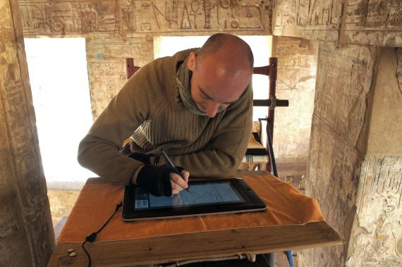 Krisztián Vértes drawing an inscription on the digital drawing tablet, Medinet Habu.  Photo by Ray Johnson