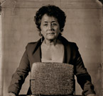 Portrait of real estate broker Margie Smigel with the Chicago Stone, a record of land transfers from 2600 BC.