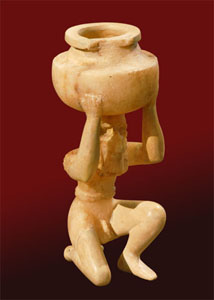 Statuette of kneeling nude male figure holding vessel, alabaster, from Shara Temple at Tell Agrab (date: ca. 2600 B.C.). Oriental Institute Museum.